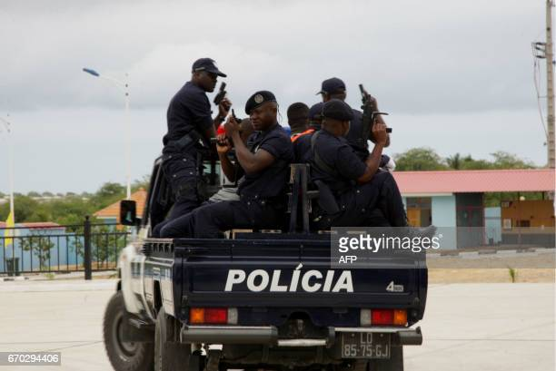 Angolan policemen are seen displaying their skills at a ceremony for the graduation of the third course of police sciences at the Police Academy in...