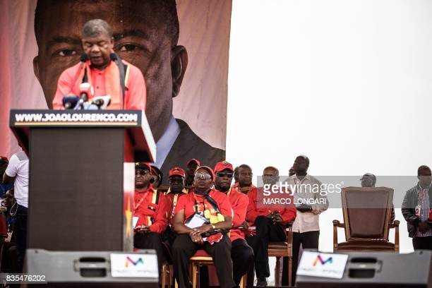 Angolan President and The People's Movement for the Liberation of Angola President Jose Eduardo dos Santos look on as MPLA candidate to the...
