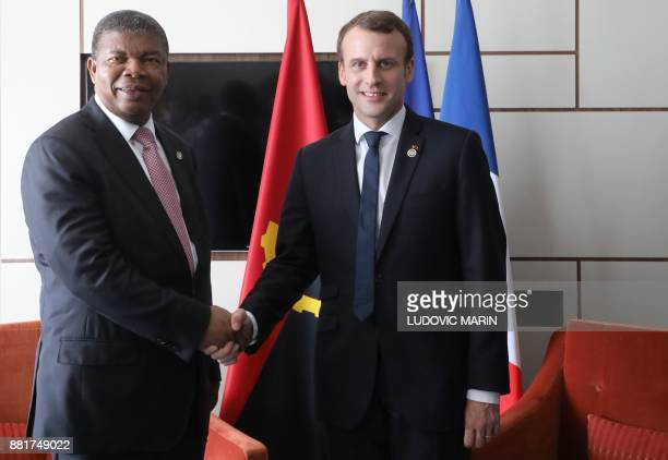 Angolan President Joao Lourenco shakes hands with French President Emmanuel Macron during a meeting on the sidelines of The Africa EU Summit in...
