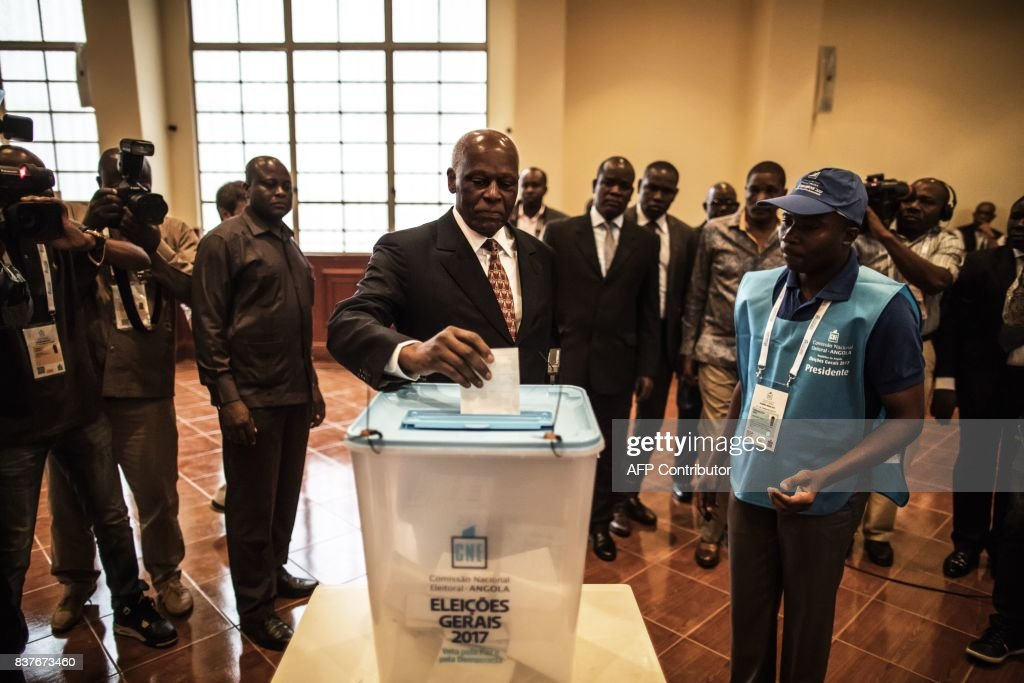 Angolan President Jose Eduardo dos Santos casts his vote in Luanda, on August 23, 2017 during the general elections. Angolans cast their ballots on August 23 in an election marking the end of President Jose Eduardo Dos Santos's 38-year reign, with his MPLA party set to retain power despite an economic crisis. /