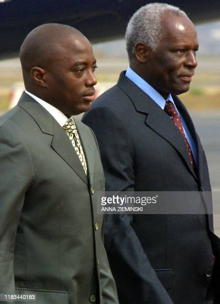Angolan President Jose Eduardo Dos Santos welcomes Democratic Republic of Congo President Joseph Kabila at the airport in Luanda for the Southern...