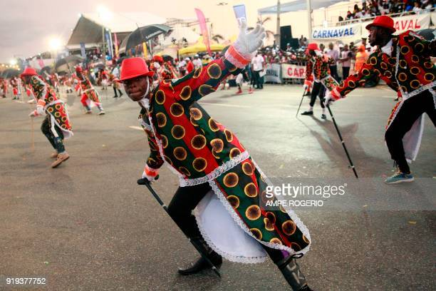 Angolan revellers wearing traditional and folkloristic attires perform during the Angolan Carnival on February 13 2018 in Luanda Angola The 2018...