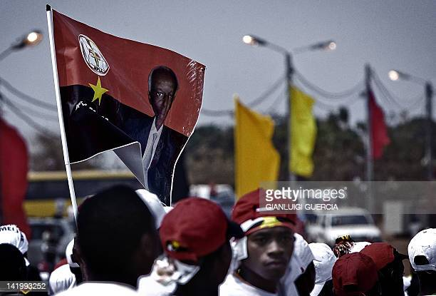 Angolan ruling party MPLA flags fly as hundreds of Angolan ruling party Popular Movement for the Liberation of Angola supporters gather on August 30...