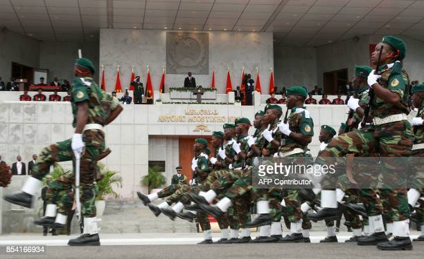 Angolan Security force members parade in front of the newly elected Angolan President Joao Lourenco during his swearing in ceremony as the new...