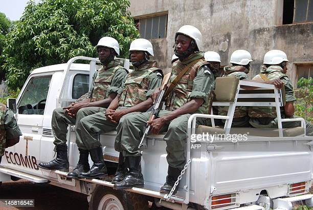 Angolan troops who arrived in March 2011 as part of a bilateral military agreement with GuineaBissau sit on a truck as they prepare to leave Bissau...