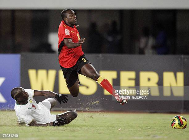 Angolan's midfielder Mateus Costa is tackled by Senegal's defender Souleymane Diwaara 27 January 2008 during the 2008 African Cup of Nations match at...