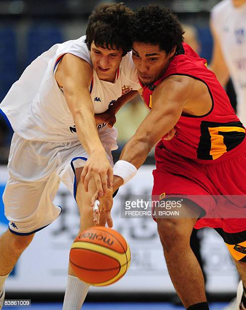 Angola's Armando Costa vies for the ball with Serbia's Dusan Katnic during their Stankovic Cup basketball game in Hangzhou on July 20 2008 in eastern...