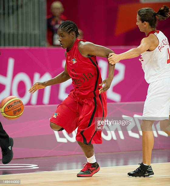 Angola's Astrida Vicente is fouled by Turkey's Emine Tugba Alazoglu during their game at the Basketball Arena at the Olympic Park during the 2012...