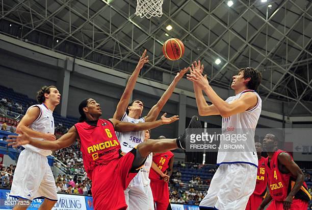 Angola's Carolos Morais vies for the rebound with Serbia's Marko Keselj and Boban Marjanovic as Nikola Koprivica Olimpio Cipriano and Eduardo Mingas...