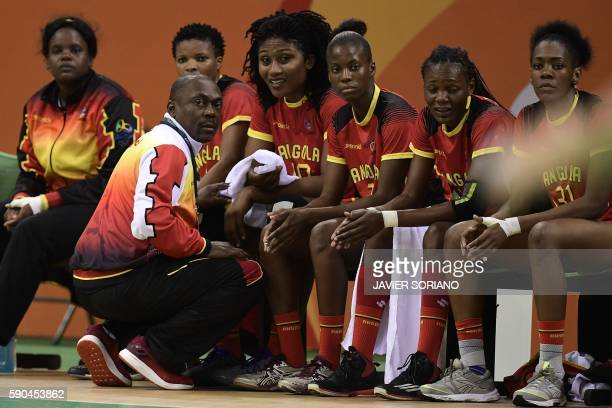 Angola's coach Filipe de Carvalho Cruz gives instructions to his players during the women's quarterfinal handball match Russia vs Angola for the Rio...