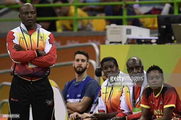 Angola's coach Filipe de Carvalho Cruz stands past his players during the women's quarterfinal handball match Russia vs Angola for the Rio 2016...