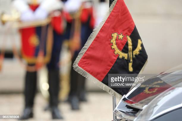 Angola's flag is pictured on the official car of Angolan president in the courtyard of the Elysee presidential palace on May 28 2018 in Paris
