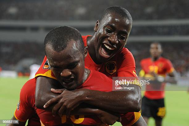 Angola's Flavio celebrates a goal with Djalma Campos during the Group A African Nations Cup match between Angola and Mali at the November 11 Stadium...