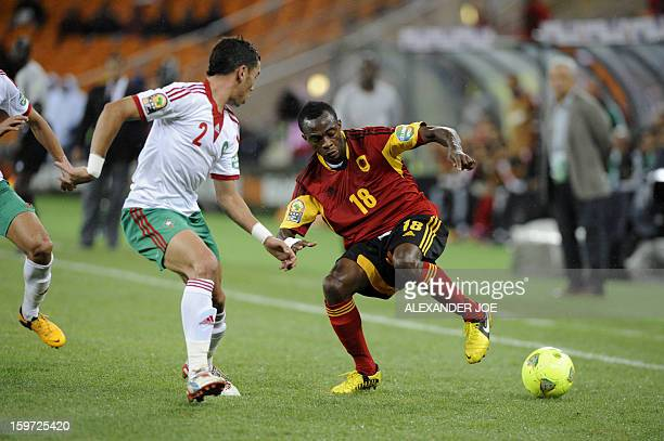 Angola's forward Geraldo vies with Morocco's midfielder Nordin Amrabat during the Morocco vs Angola CAN2013 football match at Soccer City in Soweto...
