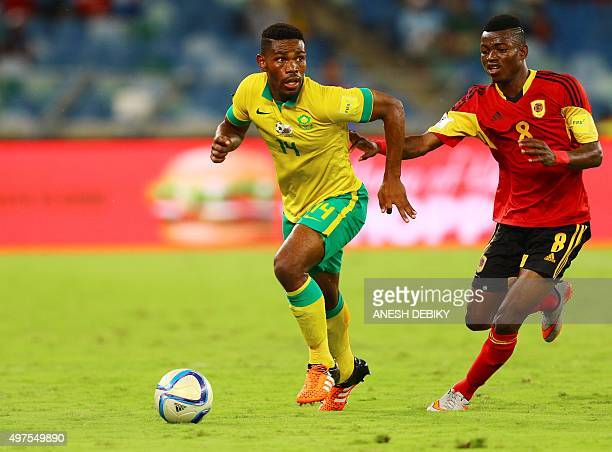 Angola's Jacinto Muondo Dala vies with South Africa's Thulani Hlatshwayo during the 2018 FIFA World Cup African qualifier football match between...