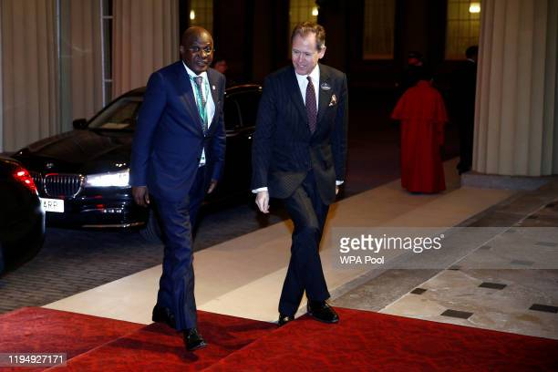 Angola's Minister of State for Economic Development Manuel Nunes Junio arrives as Prince William, Duke of Cambridge and Catherine, Duchess of...