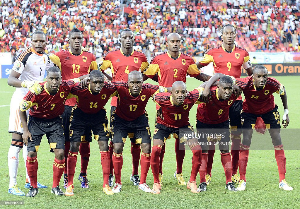 Angola's national football team pose on January 27, 2013 before a 2013 African Cup of Nation Group A football match against Cape Verde at Nelson Mandela Bay Stadium in Port Elizabeth. Front row, from left : forward Djalma Campos, defender Amaro, forward Mateu, midfielder Gilberto, midfielder Manucho Dinis, defender Pirolito. Back row, from left : goalkeeper Lama, defender Bastos, defender Dani Massunguna, defender Marco Airosa, forward Manucho.