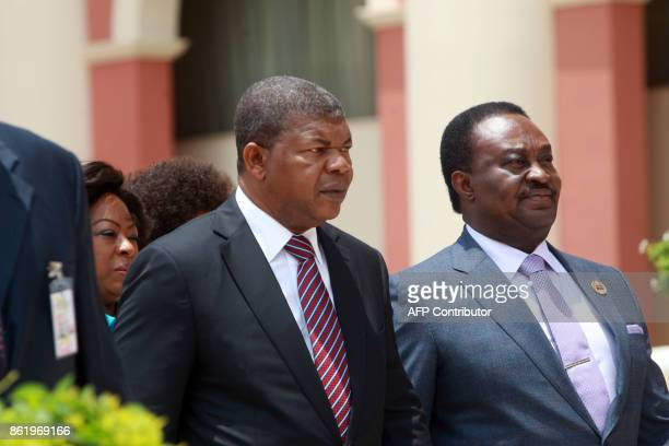 Angola's newly elected president Joao Lourenco flanked by National Assembly President Fernando da Piedade Dias dos Santos arrives at the Angola...