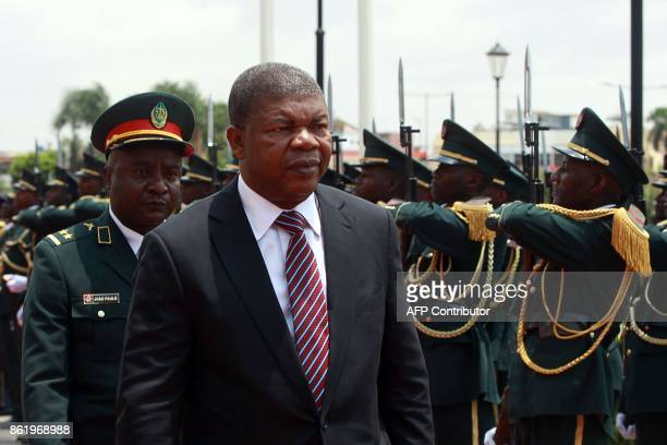 Angola's newly elected president Joao Lourenco reviews the guard of honour as he arrives at the Angola Nation Assembly to deliver his first speech in...