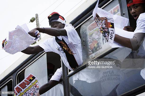 Angola's ruling party Movement for the Liberation of Angola MPLA supporters cheer on August 29 2008 as they ride in a campaign bus in the streets of...
