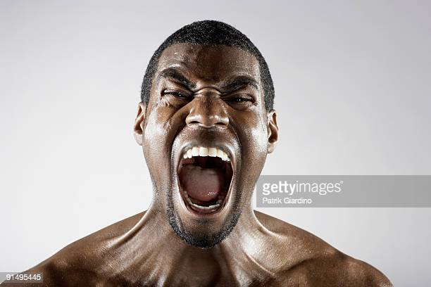 angry african man shouting - mouth open stock pictures, royalty-free photos & images