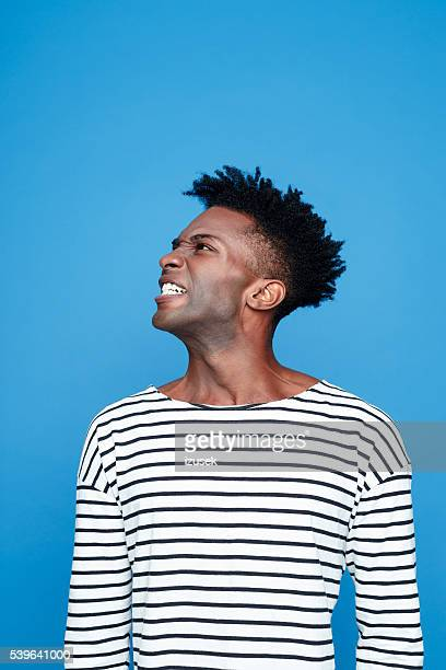 angry afro american young man - clenching teeth stock pictures, royalty-free photos & images