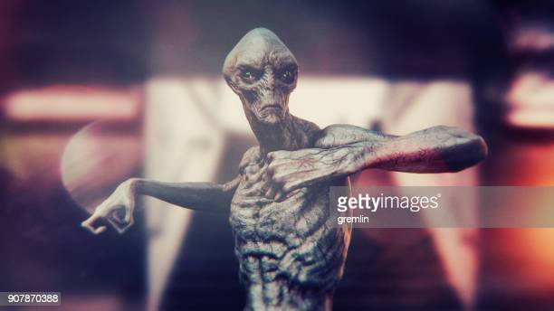 angry and irritated alien - alien stock photos and pictures