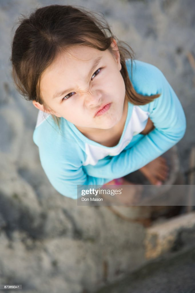 Angry Asian girl frowning : Stock Photo