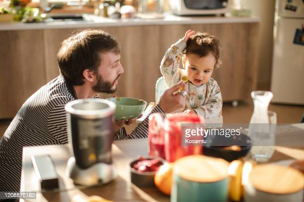 angry baby boy refusing to eat his mashed broccoli baby food - breakfast cartoon stock pictures, royalty-free photos & images