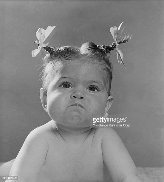 Angry baby with comical hairstyle