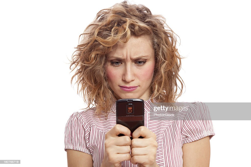 Angry beautiful blonde woman texting : Stock Photo