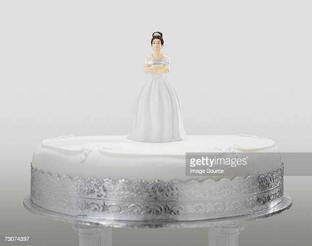 angry bride figurine on a wedding cake - bride stock photos and pictures