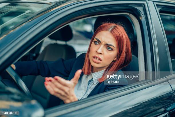 angry business woman in a car - stock trader stock pictures, royalty-free photos & images