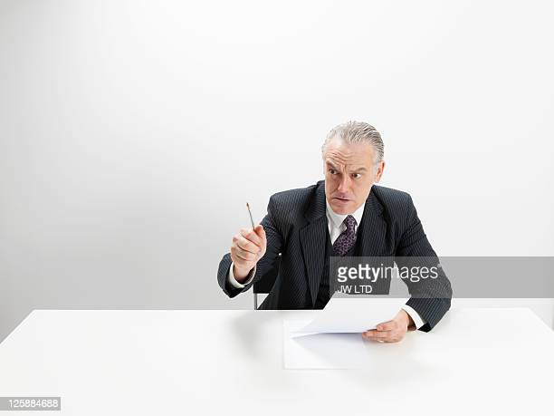 angry businessman at desk  - bossy stock pictures, royalty-free photos & images