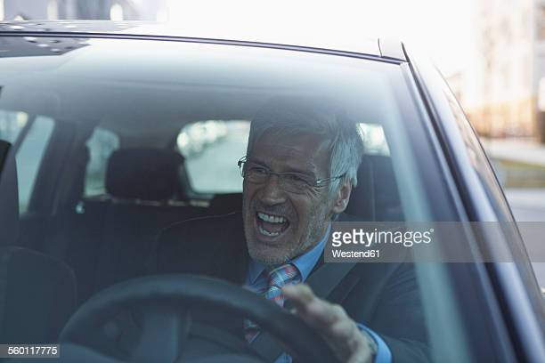Angry businessman in his car