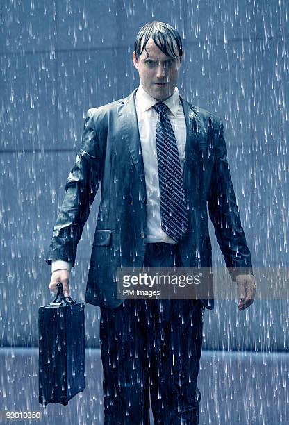 Angry businessman in rain