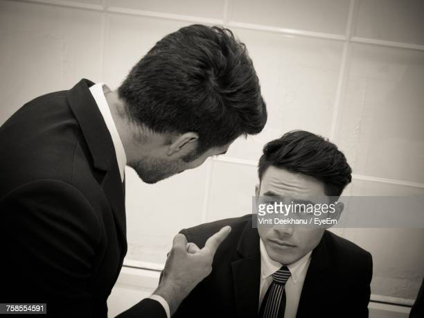 angry businessman scolding colleague in office - 説教 ストックフォトと画像