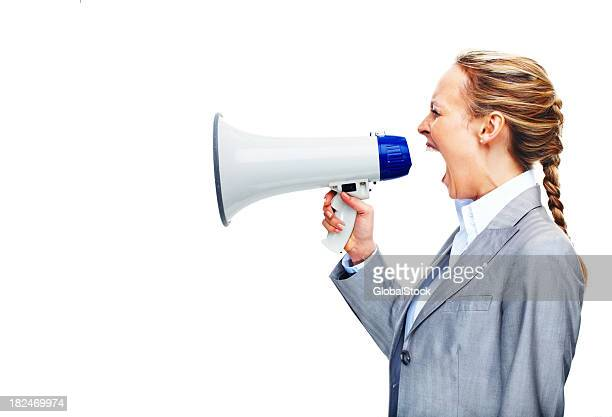 Angry businesswoman screaming into a megaphone