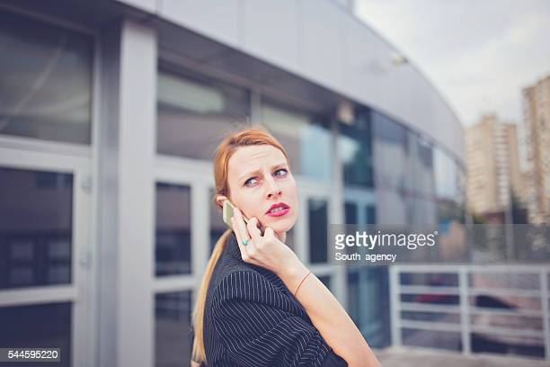 Angry Businesswoman using phone