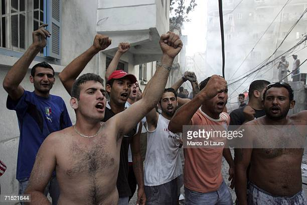 Angry civilians protest to the camera after Israeli war planes droped a bomb on a Hezbollah commander's office on July 26 2006 in Tyre Southern...