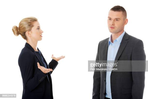 Angry Colleagues Arguing With Each Other Against White Background