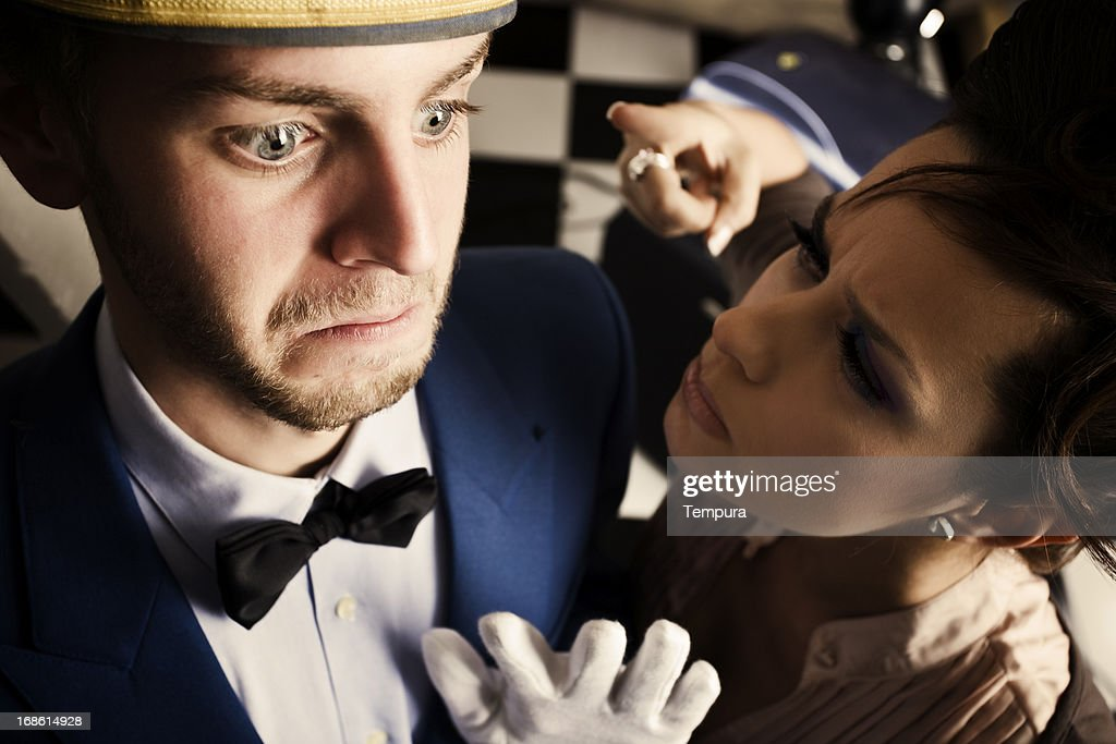 Angry costumer scolding the bell boy _ horizontal : Stock Photo