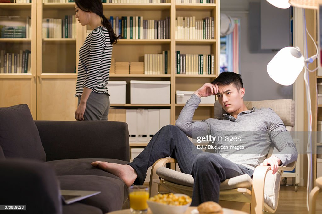 Angry couple in living room : Stock Photo