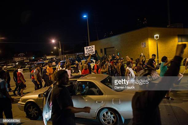 Angry crowds took to the streets for a second night to protest an officerinvolved killing August 14 2016 in Milwaukee Wisconsin Protestors threw...