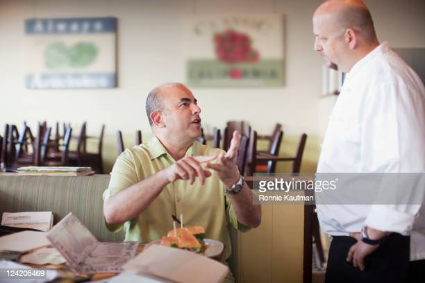 angry customer complaining to chef in restaurant - negative emotion stock pictures, royalty-free photos & images