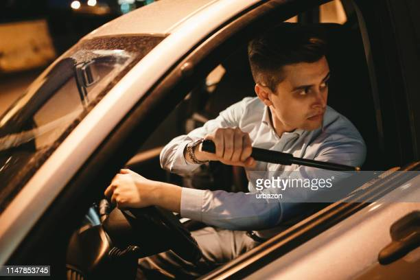 angry elegant man driving car - road rage stock pictures, royalty-free photos & images