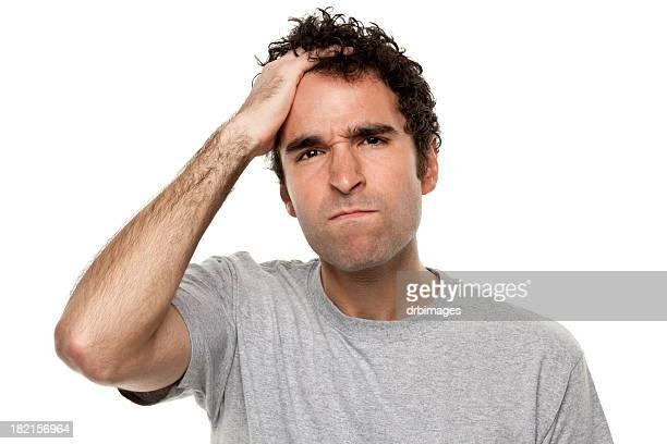 怒り Frustrated 男性、髪に手をやる