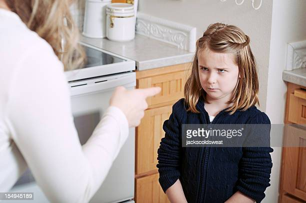 angry girl scolded by her mother - mother scolding stock pictures, royalty-free photos & images