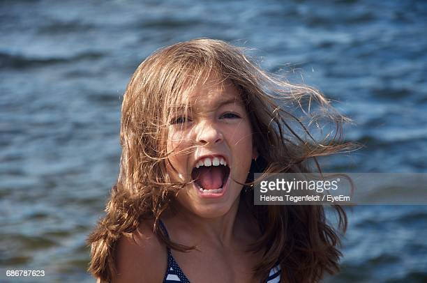 Angry Girl Shouting Against Sea