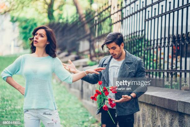 Angry girlfriend throwing bouquet